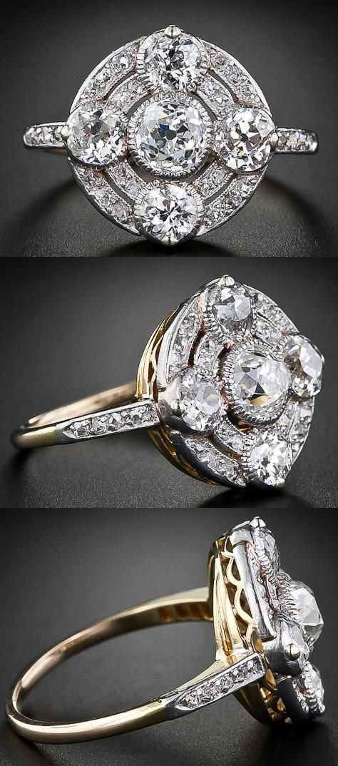 Circular antique diamond ring from the early 1900s.  Five antique old mine-cut diamonds - the central diamond weighing a half-carat - are presented atop glittering concentric circles. The setting is plantinum over gold. Via Diamonds in the Library.