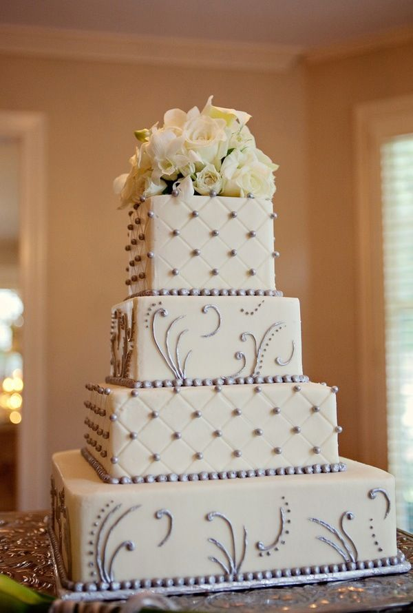 We have selected our wedding cake! We will be having this cake in a hexagon shape. Very Art Deco. The tiers will alternate between red velvet cake and white cake.
