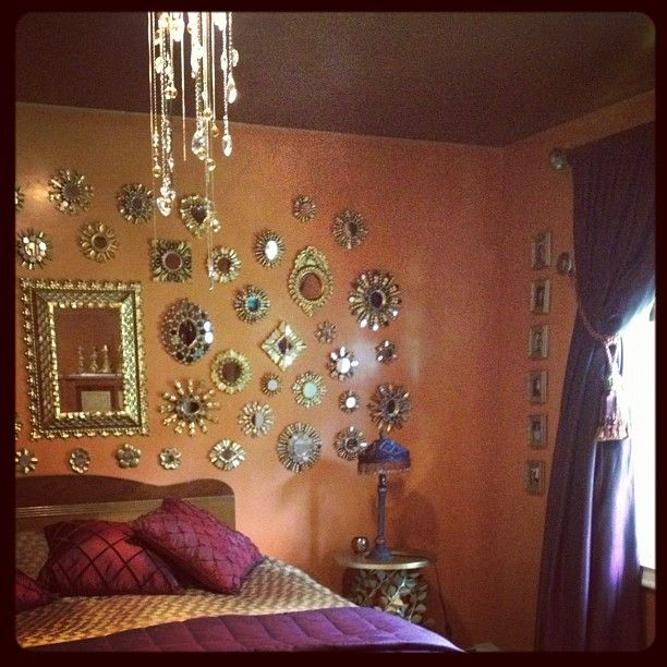 Love all the small wall mirrors like wall jewelry, dreamy stars, & décor all in one....love! Bohemian Style room décor / style
