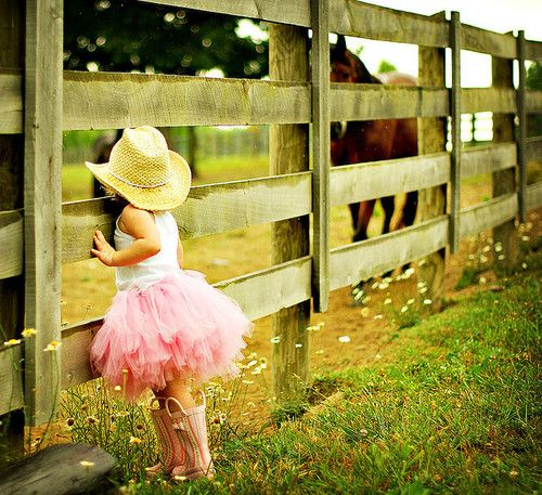 Little cowgirl waiting for her horse...