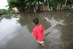 Estuar Stanley Huembes, 11, walks through the flooded roads in his neighbourhood of Tipitapa...Central America has been hit by torrential rains since last week after the succession of five hurricanes and tropical storms. Nicaragua has declared a state of emergency with 25,000 people affected by the floods. Sean Hawkey, documentary photographer