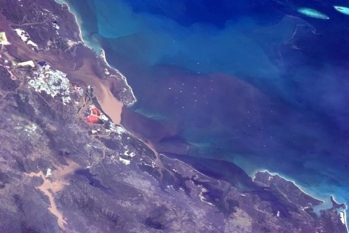 Canadian astronaut, Commander Chris Hadfield, photographed the 2013 Queensland floods while passing over central Queensland in the International Space Station. Here's what he tweeted: @Cmdr_Hadfield: The flooding and flow into the Coral Sea at Gladstone, Australia - visible from the Space Station.