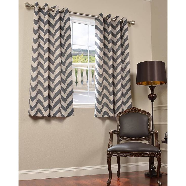 This blackout curtain combines form and function for a beautiful accent in any home. The grey and tan curtains feature a chevron pattern and insulate your room against the elements.