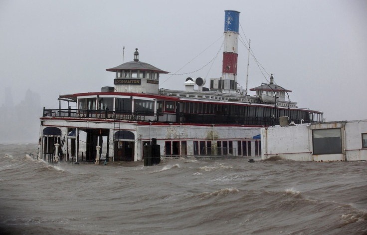 An historic ferry boat named the Binghamton is swamped by the waves of the Hudson River in Edgewater, N.J., Monday, Oct. 29, 2012, as Hurricane Sandy lashes the East Coast.