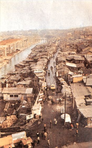 """Seoul taken in the 1950s.  Seoul, 1957. Seoul seemed quite rocky.  Seoul,1957.  Seoul. Taken by Izzet Keribar on December 1956. The below part seems to have been the """"shopping area near Yongsan"""":  Shopping area near Yongsan in 1954. Taken by Robert Furrer.  Shopping area near Yongsan in 1954. Taken by Robert Furrer. (I think this is Chungmuro/Myeongdong, not sure thus).  A aerial photograph show.."""