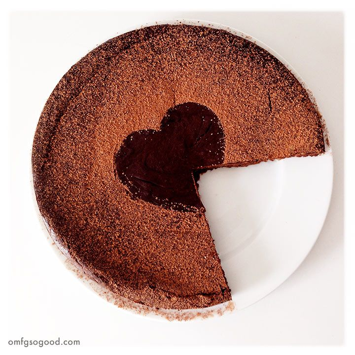 There really are only two words necessary to describe this cake... Pure decadence. Hell, even that's an understatement. I simply adore flourless chocolate cake. There is just something about the co...