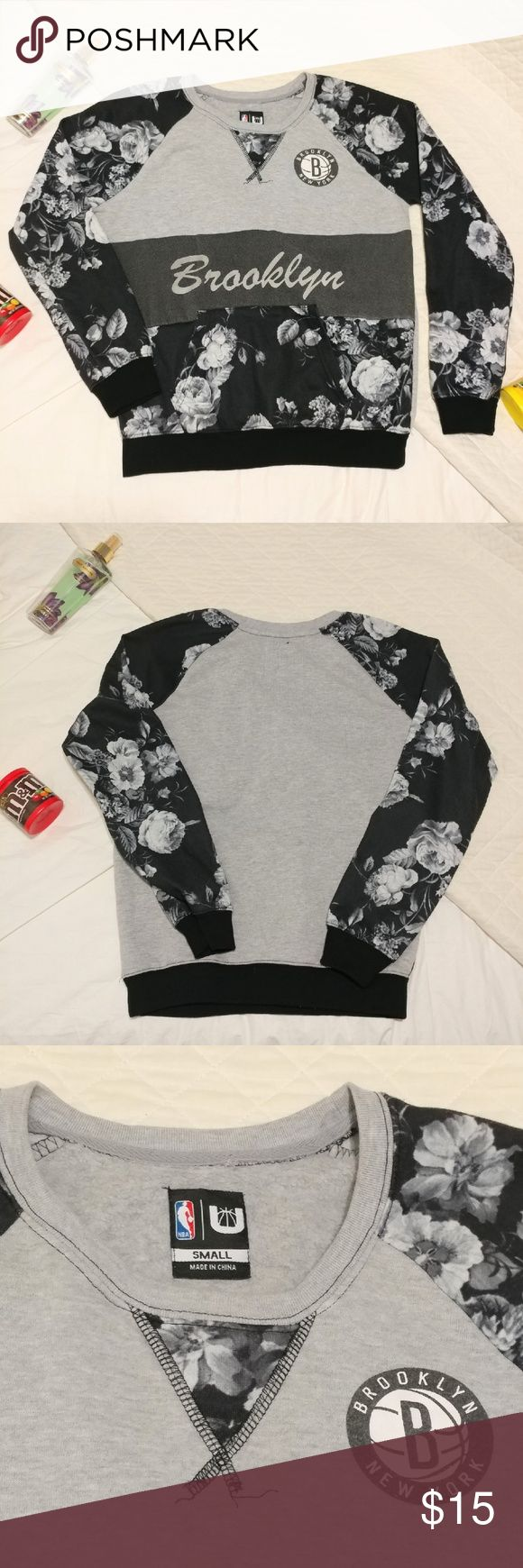 Brooklyn Nets Women's Floral Sweatshirt Used item. Adorable floral black and white sweatshirt. Size Small.  ??Reasonable offers are welcomed  ??No trades Tops Sweatshirts & Hoodies