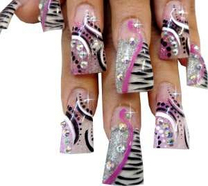 DUCK FLARE NAIL TIPS    This nail art design was created by Erika Ortiz in Detroit Michigan using Crystal Clear Duck Flare Nail Tips.  Techno Color Arylic Powder in Satin Snow White, Sparkling Silver and Sparkling Pink were encapsulated in Clear Acrylic Powder.  Using flat nail art paint and rhinestones, each nail features a unique yet coordinated nail art design.