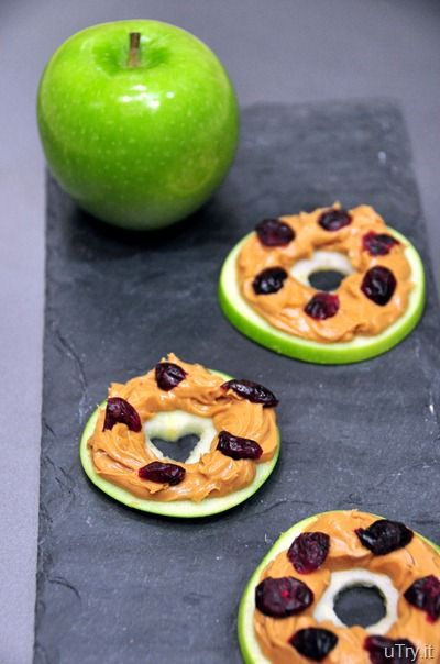 Kids' snack: Green apple slices with peanut butter and cranberry