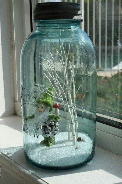 Large old blue Mason jar filled with a einter display.