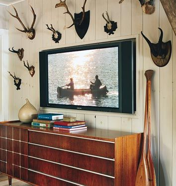 planked walls and antler collection thom filicia domino