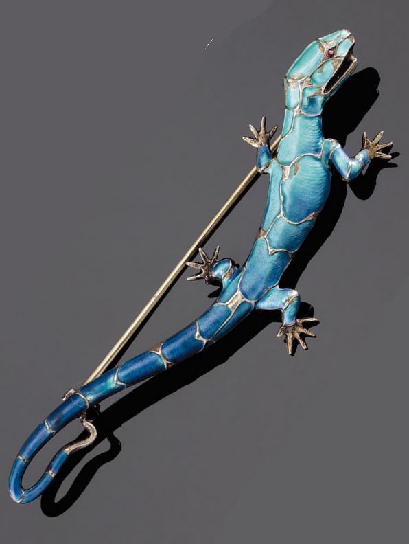 An art nouveau enameled silver salamander brooch, by Meyle & Mayer. Realistically modelled with a red paste eye, maker's mark, 9.5cm. long, circa 1900.