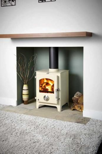 Simple white fireplace with cream stove