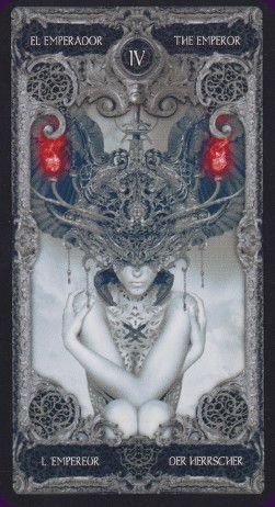 The XIII Tarot is very literally a dark deck; illustrated in greys and blacks with highlights in red. The artwork on the major arcana is a little gothic and a little Giger-esque, while the minor arcana have simple arranged pips without scenes.