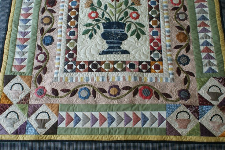 Pieced an Appliqued by Lynette Heyes.Quilted by Merle Gilson.