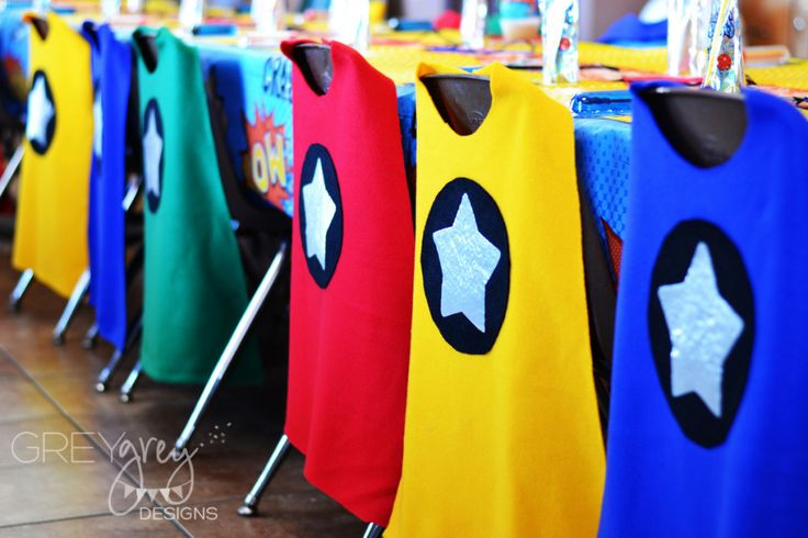 Capes on each chair of this super-hero birthday party - what little boy or girl wouldn't LOVE this?!