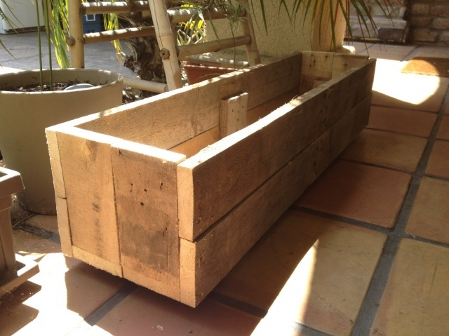 My brand new planter box! Made out of Pallets... Of course. It'about 4 feet long.