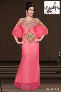 Beautiful Baby Pink Kaftan, with heavy hand beading around the neck. Shiny Gold and White crystal like beads.