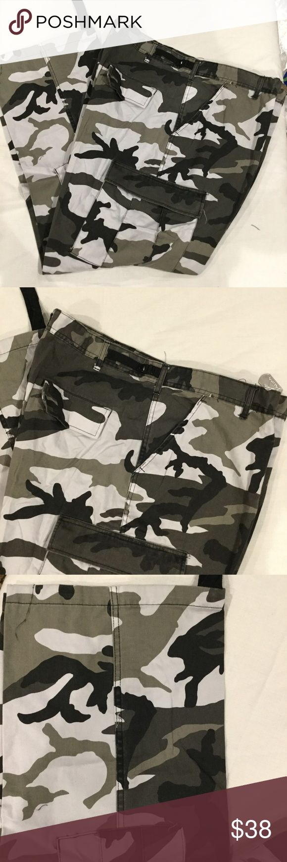 """NWT Rothco Tactical City Camouflage Cargo Pants Rothco Military Division pants are 50% polyester, 50% cotton.The cargo pants are size XXL Regular and measure 43"""" to 47""""around the waist and have a 29 1/2 to 32 1/2 in inseam.  The tags reads waist 43 to 47 inseam 29 ½"""" to 32 ½"""".  They have two slash pockets on the front, two button down patch pockets on the back and two button down patch cargo pockets. There are bottom ties at the cuff. Rothco Pants Cargo"""