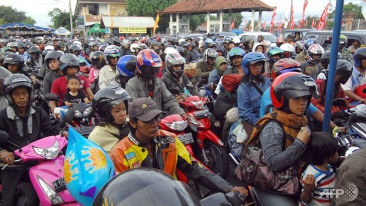 Safety: Indonesian motorcylcists ride a bus back to their hometown, and the govornmet provides tranportation for their bikes, to prevent motorcyle wrecks.