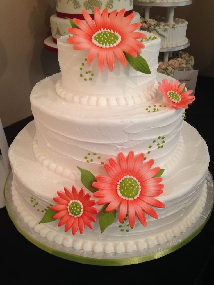 "Three tier buttercream wedding cake with gerberas ""Rustic Charm"" www.artisticcakedesign.ca #weddingcake #wedding #cake #buttercream"