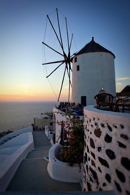 Photo of a windmill at sunset in Oia, Santorini, Greece. We stayed to the right of this :)