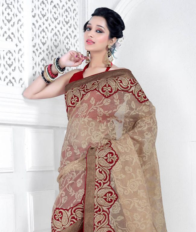 Swathe the best and look like an ethnic Diva! Drape your self with this beautiful collection that exhibits various beautiful colors and various designs. The comfort of fabric and quality defines beauty itself. So flaunt your traditional style with grace and class! BRAND: BrijrajCATEGORY: Saree with Unstitched BlouseARTICLECOLOURMATERIALLENGTHSareeBrown and RedNet Jacquard, Bhagalpuri Silk5.40 metersBlouseRedPoly Dupion0.80 meterWe would always want to send you what we showcase but there ...