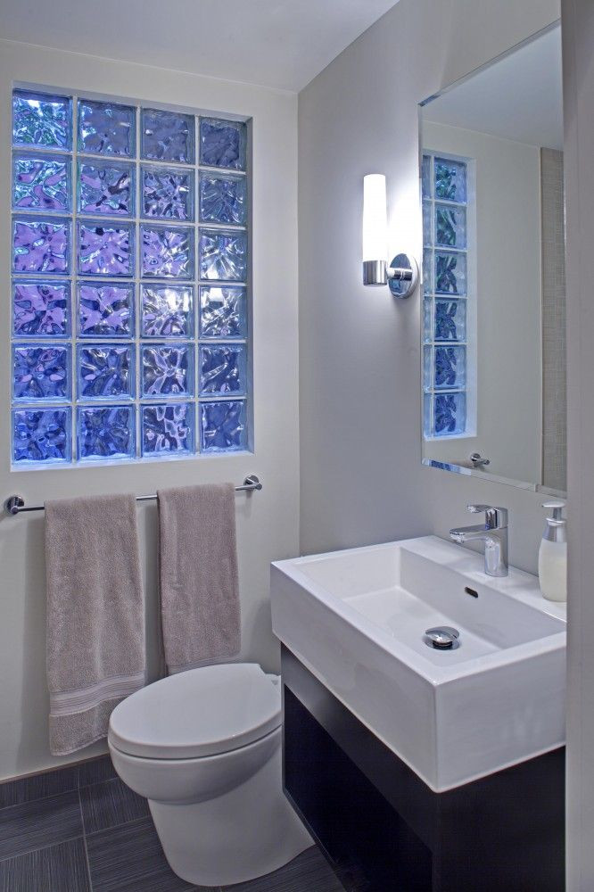 Love the clear bricks for the bathroom window. Lets in light, but you don't have to worry about curtains.