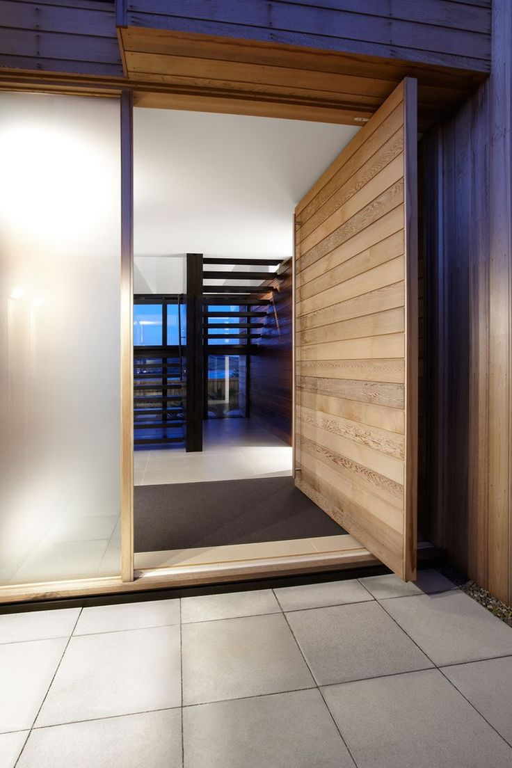 Oversized wooden front door, Lamble Residence, on the South Coast of Australia