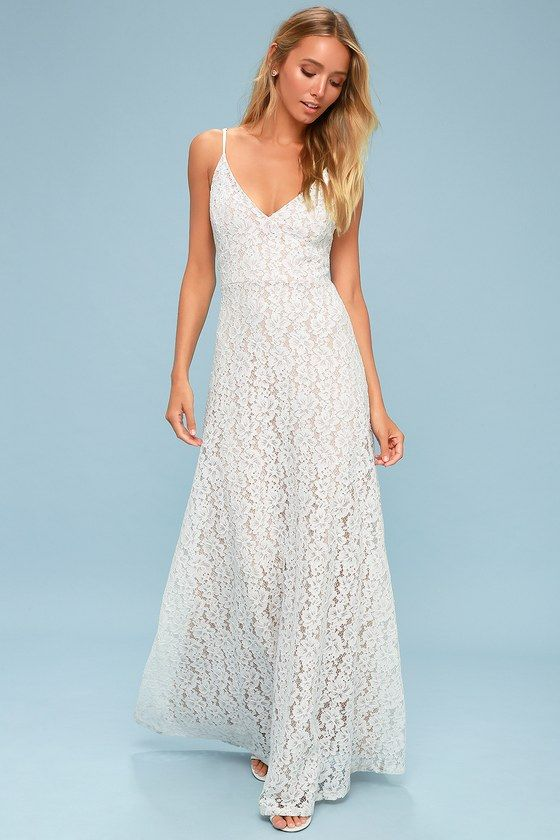 2867ae333d7e Lulus Exclusive! Fall in love with the Lulus Cressida White Lace Maxi Dress!  An elegant floral lace overlay, atop a nude liner, shapes a sultry triangle  ...