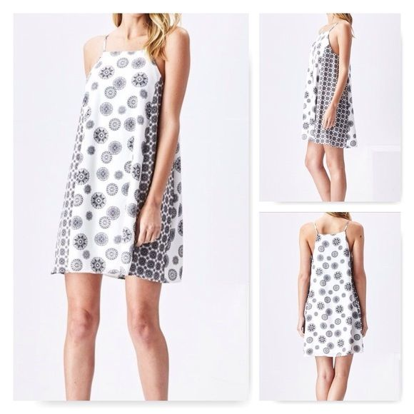 Sadie & Sage Daisy Dress Very cute black and white daisy print dress with contrasting side panels. Made from polyester/spandex.    Price is firm unless bundled. Offers not accepted on retail items. Sadie & Sage Dresses