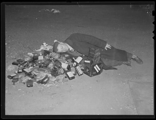 Man rests after a night of celebrating the end of the Prohibition era, 1933.