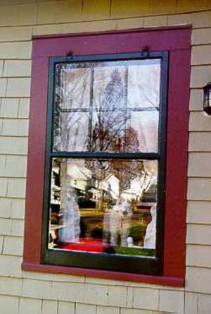 Wood storm windows are hung by hooks above and provide better insulation than new thermapane replacement windows. Read why. http://www.oldhouseguy.com/window-replacements/
