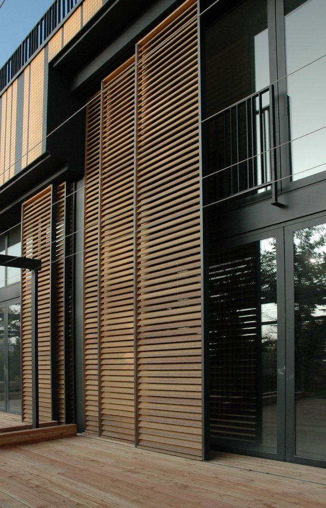 Sliding exterior louver system villa artes for Wood doors and shutters