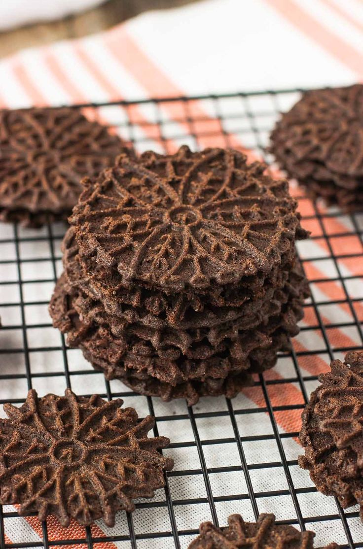 Rich dark chocolate pizzelle cookies are thin, crisp and decoratively imprinted. Great for the holidays, making sandwich cookies, or fun cannoli shells.