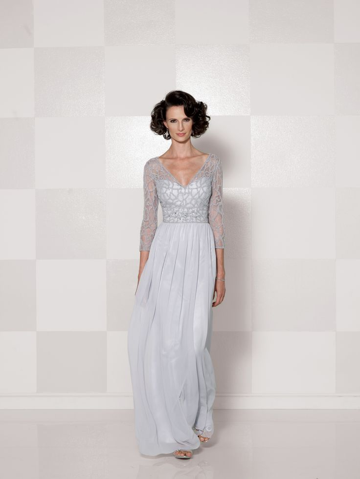 Chiffon A-line dress with hand-beaded illusion three-quarter length sleeves, V-neck beaded illusion over a sweetheart bodice with empire waistline and keyhole back, gathered skirt, suitable as a mother of the bride dress or a formal gown.Sizes: 4 - 20,16W – 26W