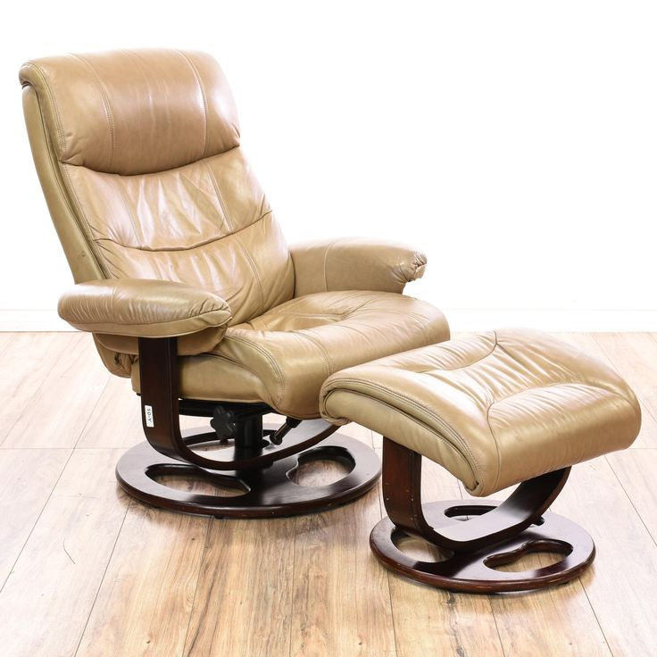 "This ""Lane"" recliner and ottoman are upholstered in a durable tan vinyl. This contemporary style ergonomic lounge chair and footstool have a round wooden swivel base, plush cushions, and a reclinable chair. Perfect for relaxing! #contemporary #chairs #armchair #sandiegovintage #vintagefurniture"
