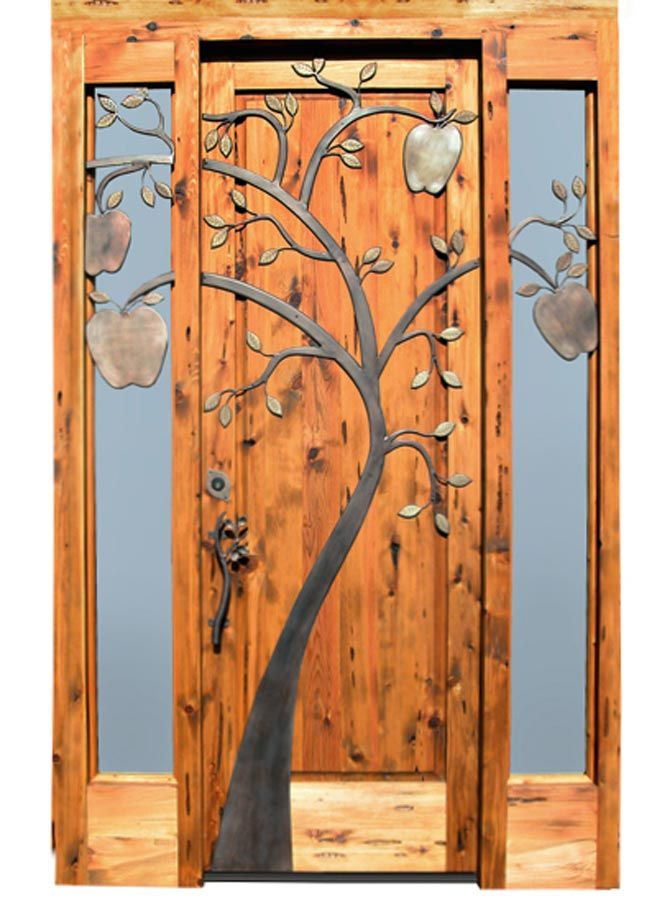 This combo of metal artwork on an already beautiful door, especially with the art growing into the outside section of the door, is spectacular.