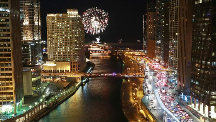 New Year's Eve Chicago - Fireworks above Navy Pier, as seen from the terrace of Sixteen restaurant at Trump Hotel Chicago, on Jan. 1, 2015.