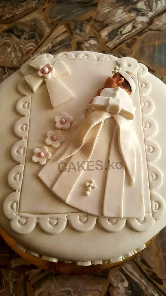 Did the baby Christening cake for a little princess..Click link to my business page for more of my work.
