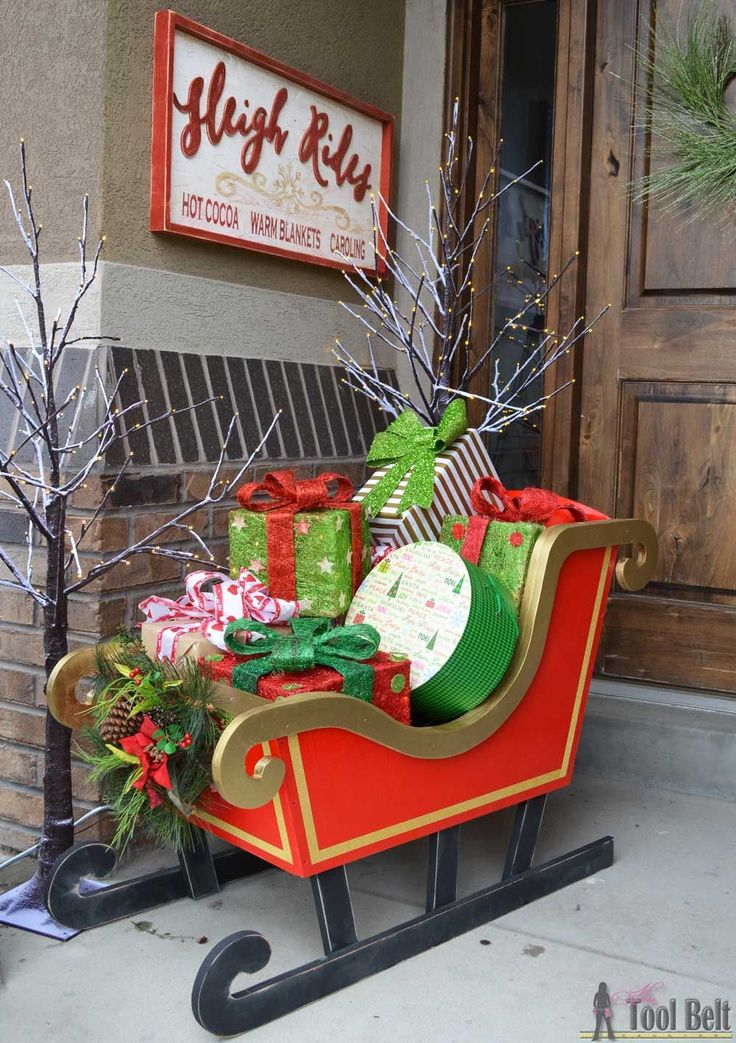 "DIY Santa Sleigh with free pattern. ~ ""Here comes Santa Claus, here comes Santa Clause, right down Santa Claus lane…"" Welcome guests with a DIY Santa Sleigh ""that's filled with toys for boys and girls again""."