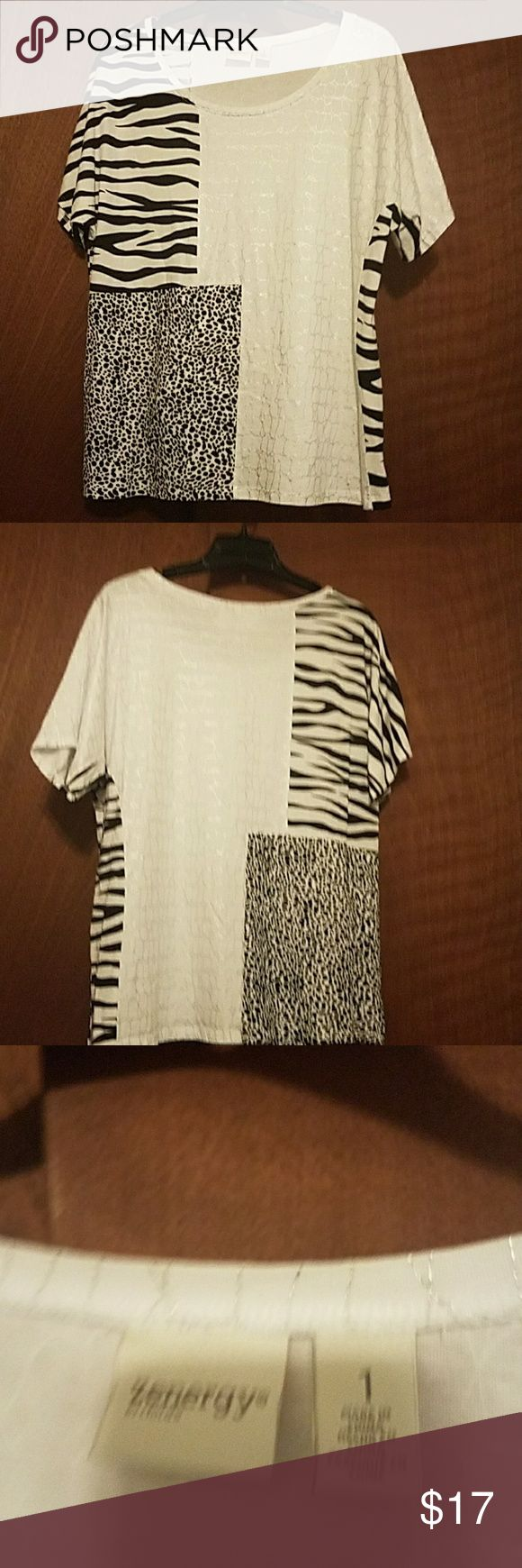 Zenergy by Chico's fun top Very cute and chic Patchwork animal print short sleeve top buys energy. Their size 1 which is a size 8. Excellent used condition. This would be such a cute top to wear for date night! zenergy by Chico's Tops Blouses