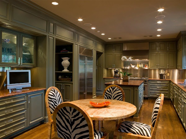 Great Elements Of This Kitchen Cabinet Color Wood Floors Stainless Backsplash And Zebra Animal Print Dinning Chairs