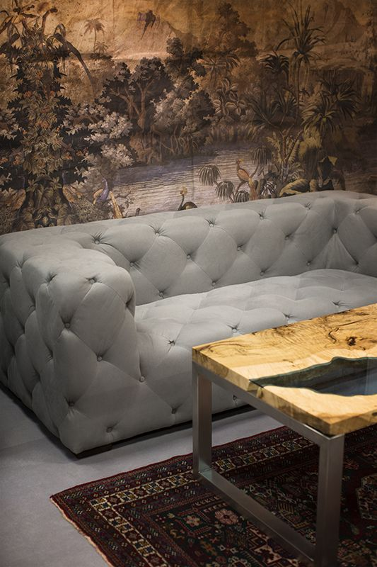 Sofas Alberta. River table. Wallpaper. Modern and oryginal sofa. Table made from selected maple wood with blue or white glass placed inside it. It seems to be a meandering river. Sofa price: 5 350 PLN