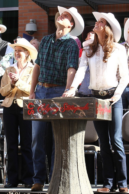 Great examples of western wear. ~ Calgary Stampede Parade | Flickr - Photo Sharing! July 8, 2011.