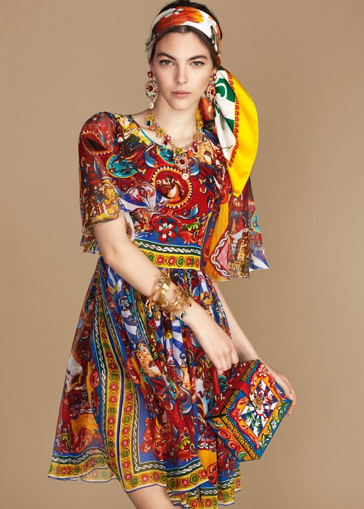 The colours and prints of the Sicilian Carts become fun accessories, gowns  and sun dresses