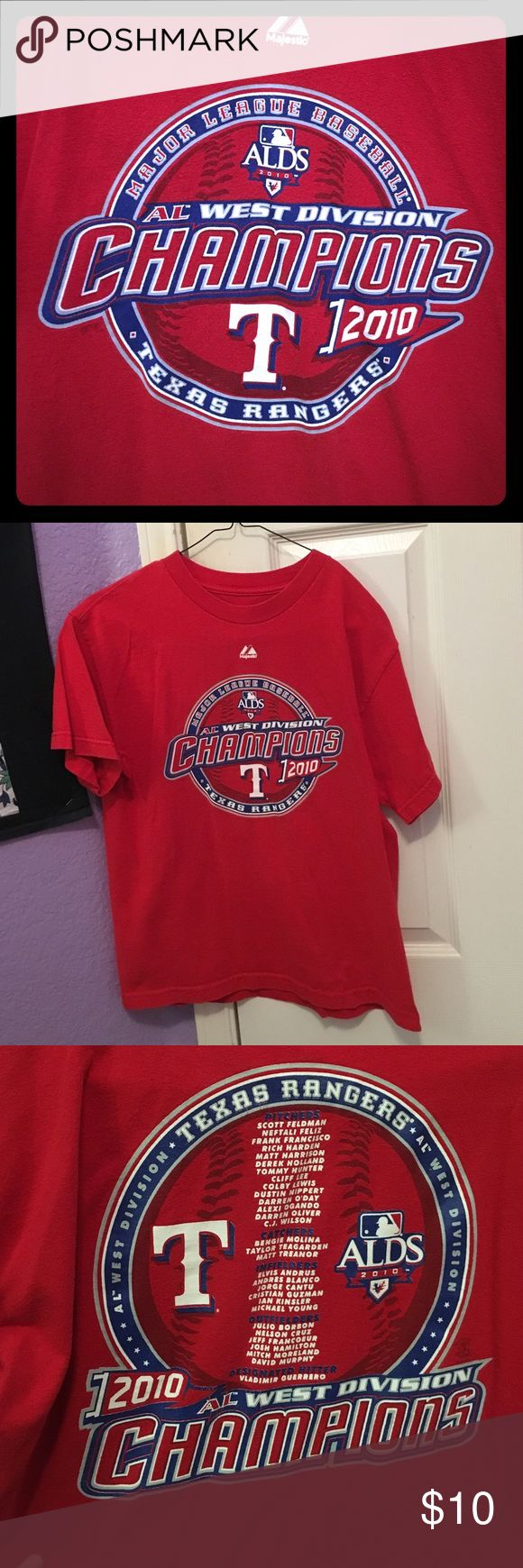 Texas Rangers Shirt Tee from when the Rangers won the AL West in 2010. Roster listed on the back. Does not say a size but fits like adult small. Used but in good condition. PLEASE READ THE ENTIRE DESCRIPTION BEFORE PURCHASING! 🚫 NO TRADES. NO HOLDS. NO MERC@RI 🚫📩 I only respond to offers made through the offer button 📩  🙋🏼Questions? Just ask! Serious inquiries only please. EVERYTHING MUST GO!! 💁🏼 Majestic Shirts Tees - Short Sleeve