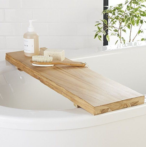 Natural bath. Bring nature to the tub with gorgeous teak wood bath caddy, complete with rustic live edges. An adjustable track along the bottom makes it fit tubs of all sizes. CB2 exclusive.