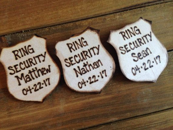 Gifts for Ring Bearers! Police style badges for all of the little boys personalized with their name, and your wedding date! Great photo props too!!  SET of 3 badges for sale here but ANY amount is available.  How adorable for your little guys! This Police style badge will make them feel extra special walking those rings down the aisle. Each one says Ring Security, their name and your wedding date.  Each measures approx 3x4 and has a pin on the back to easily wear.  They will just LOVE this…