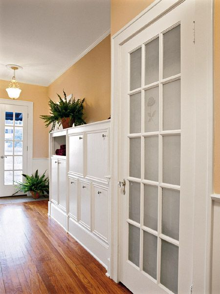 These homeowners turned a long, wide hallway into a laundry area. The transformation began with the closet that holds a stackable washer/dryer. (Photo: Photo: Laurey W. Glenn; Stylist: Lisa Powell)